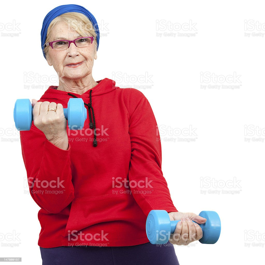 Femme âgée avec des poids et haltères. photo libre de droits