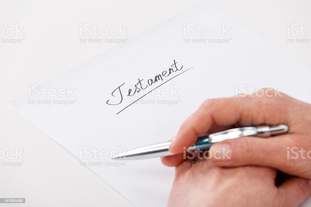 elderly woman writing testament stock photo