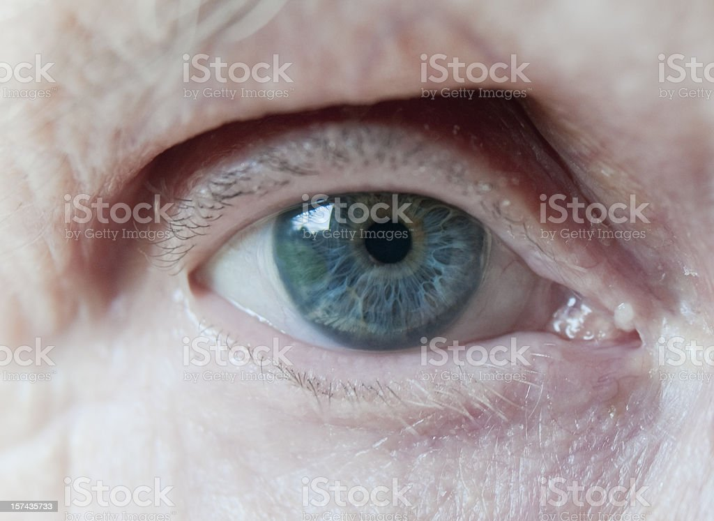 Elderly Womans Blue Eye stock photo