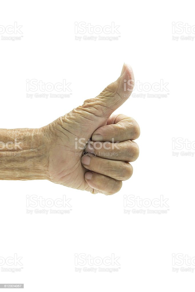 elderly woman's hand showing thumbs up on white back stock photo