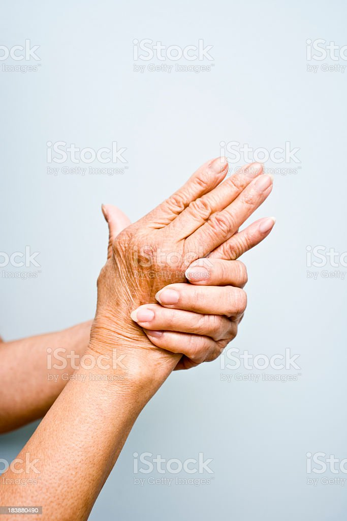 Elderly woman's with arthritis in her hands royalty-free stock photo