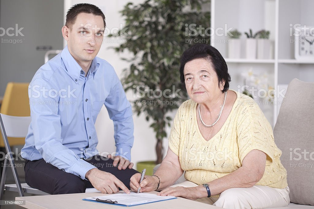 Elderly women with consultant. royalty-free stock photo