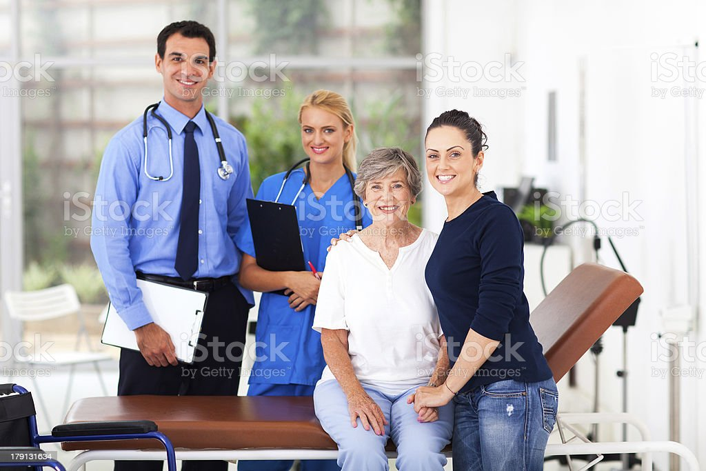 elderly,her daughter in hospital with doctor and nurse royalty-free stock photo