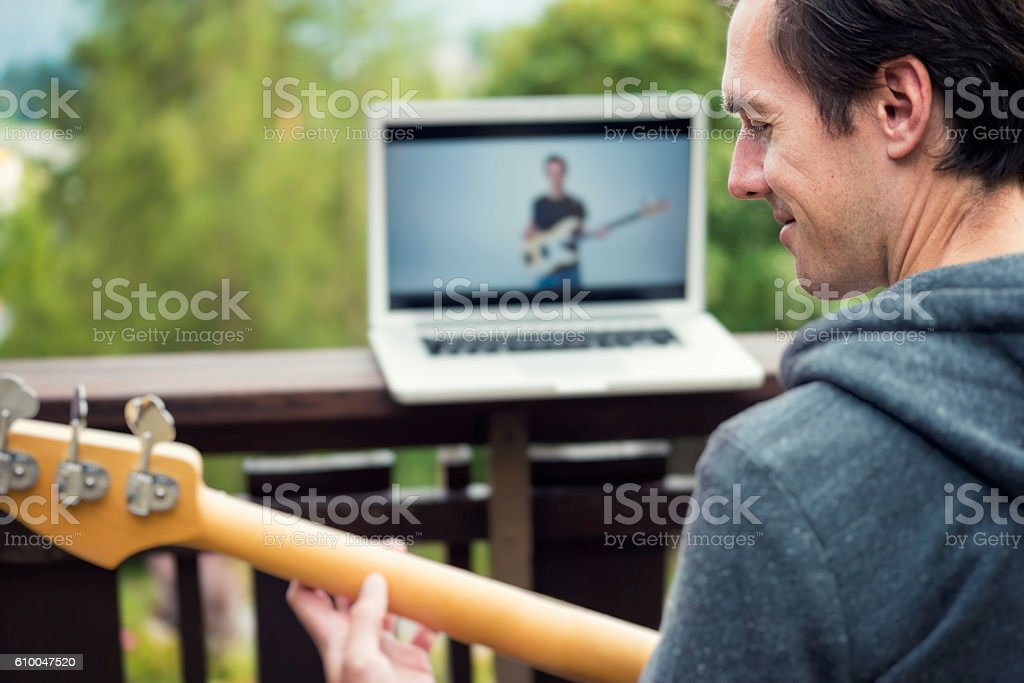 E-Learning and Online Education with a Bass Guitar stock photo