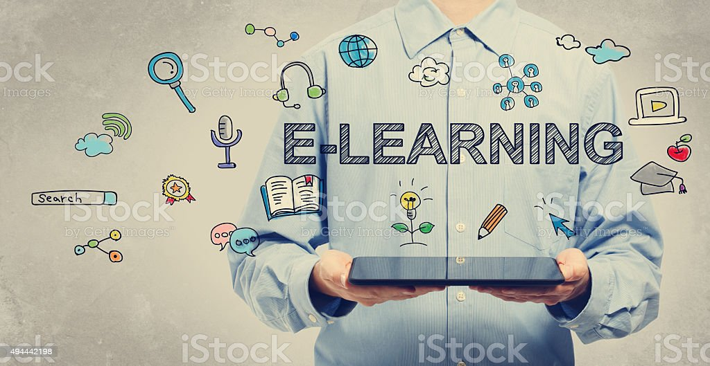 E-learning concept with young man holding a tablet stock photo