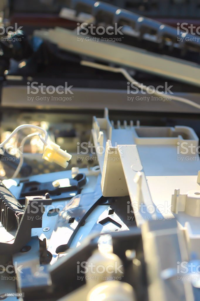Elecrotechnical technological garbage - plastic and electro material, vertical stock photo