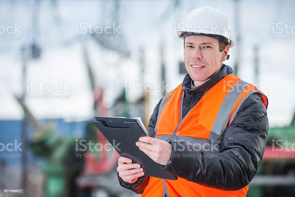 electician with substation on the background stock photo