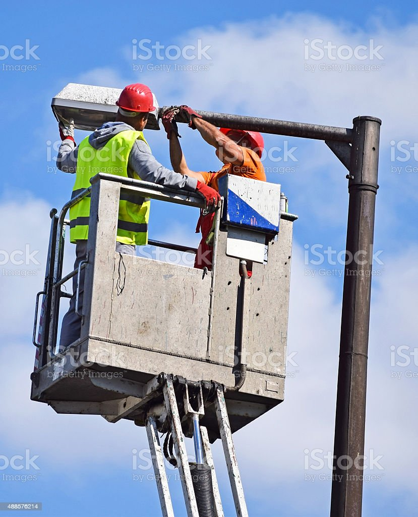 Electicians are fixing a street light stock photo