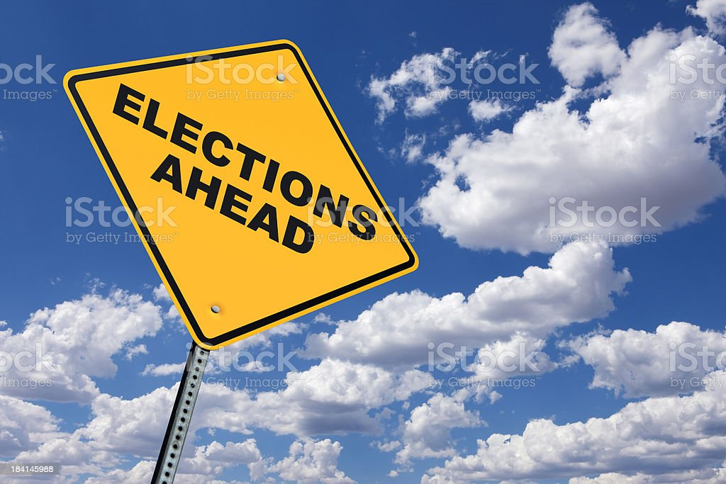 Election Ahead road sign in front of cloud filled sky royalty-free stock photo