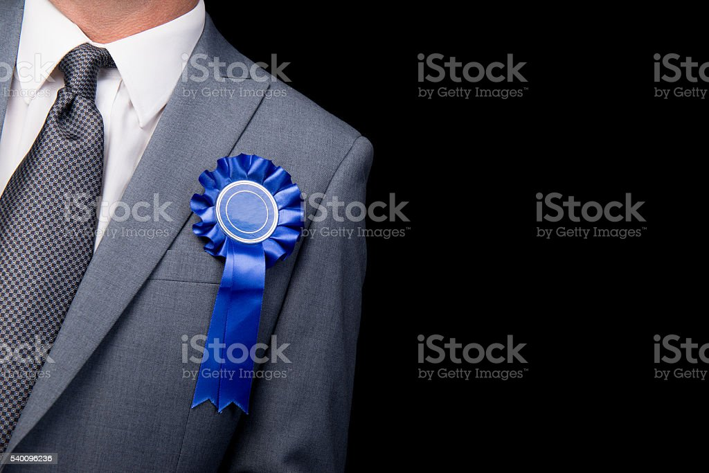 Election Candidate - Blue Rosette stock photo