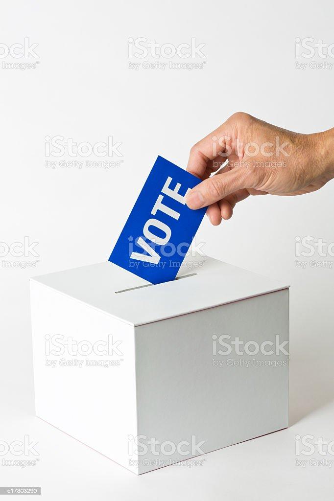 US Election Inserting Vote into Voting Ballot Box stock photo