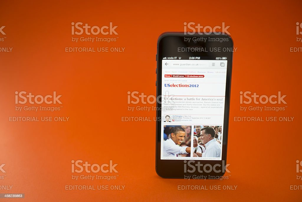 US 2012 election on smartphone Apple Iphone 5 royalty-free stock photo