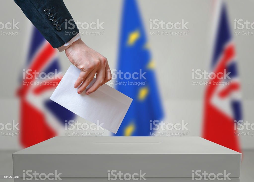 Election or referendum in Great Britain. Voter holds envelope. stock photo
