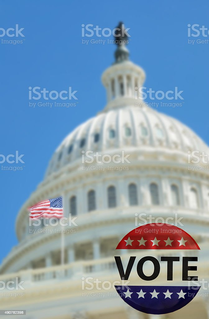 Election VOTE campaign buttons over capitol dome stock photo