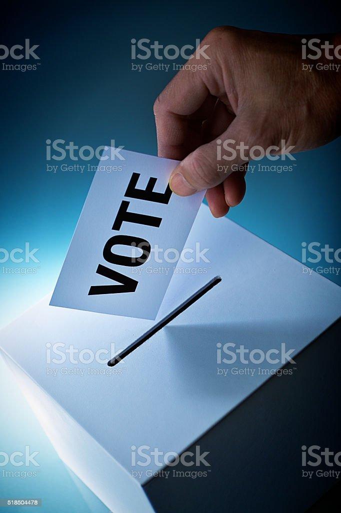 Election Voter Voting Ballot Over Ballot Box stock photo