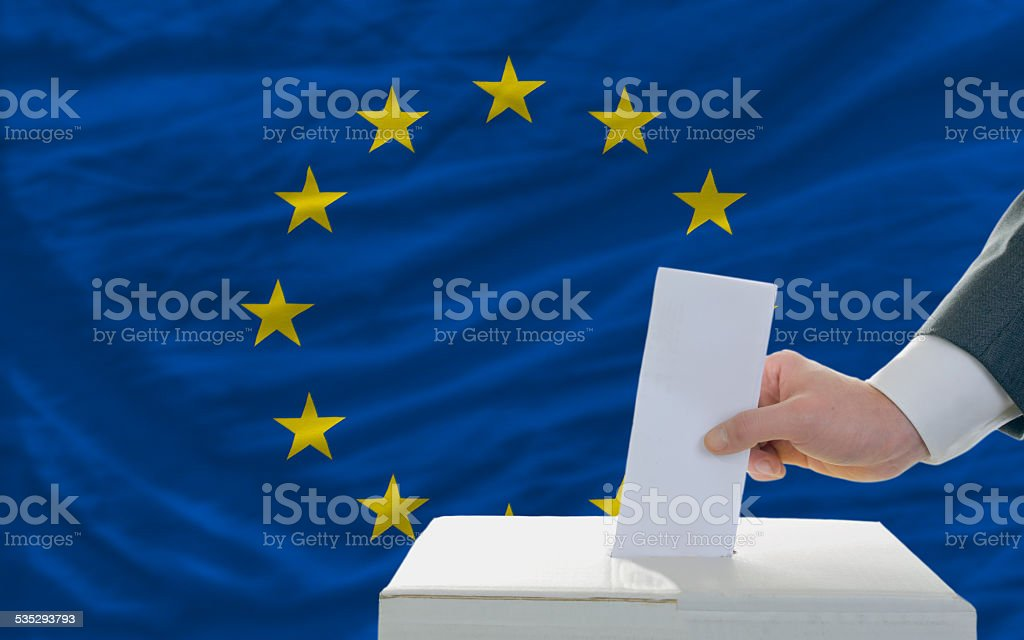 elections voting in front of flag of europe stock photo