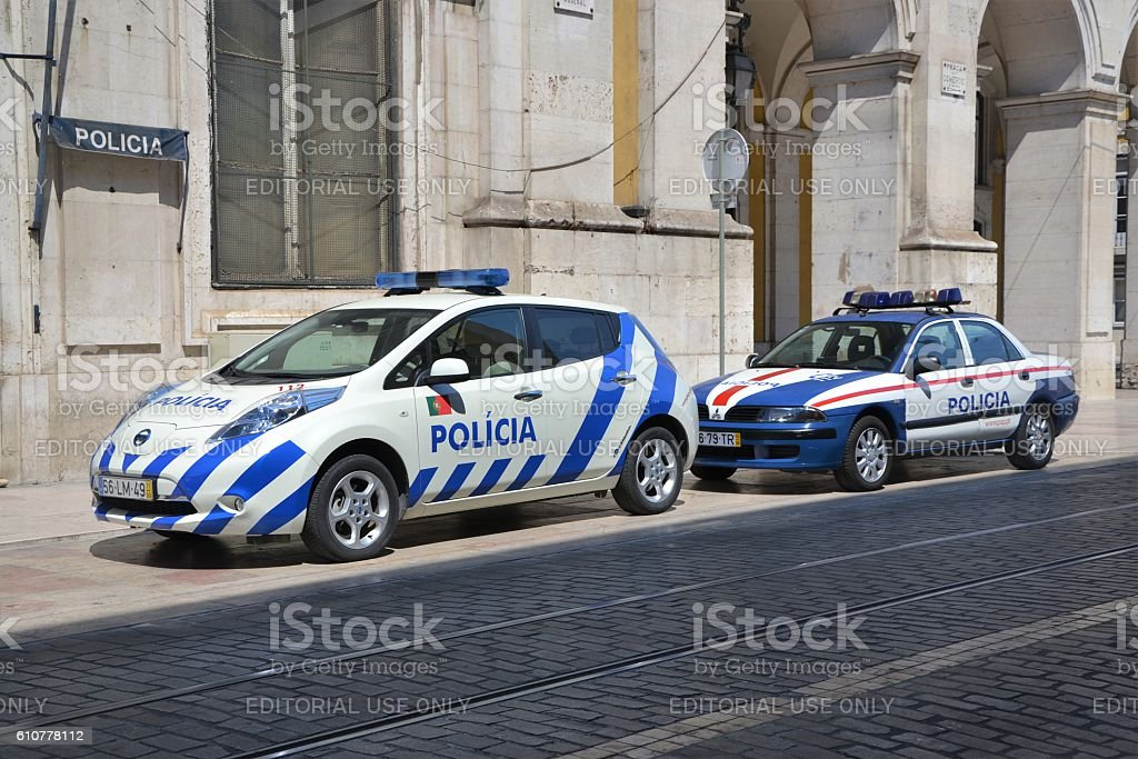 Electric and classic police car on the street stock photo
