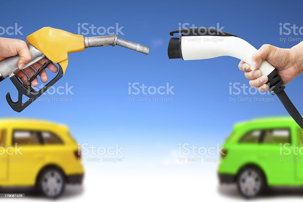 electric  and gasoline car concept stock photo