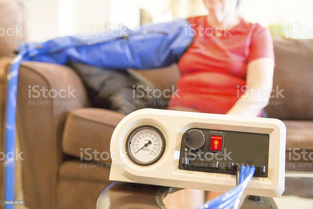 Electric arm pump used for in home lymphedema therapy stock photo