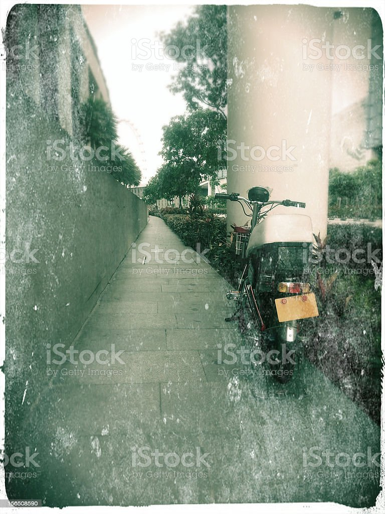 Electric Bicycle with licence plate on the footpath stock photo