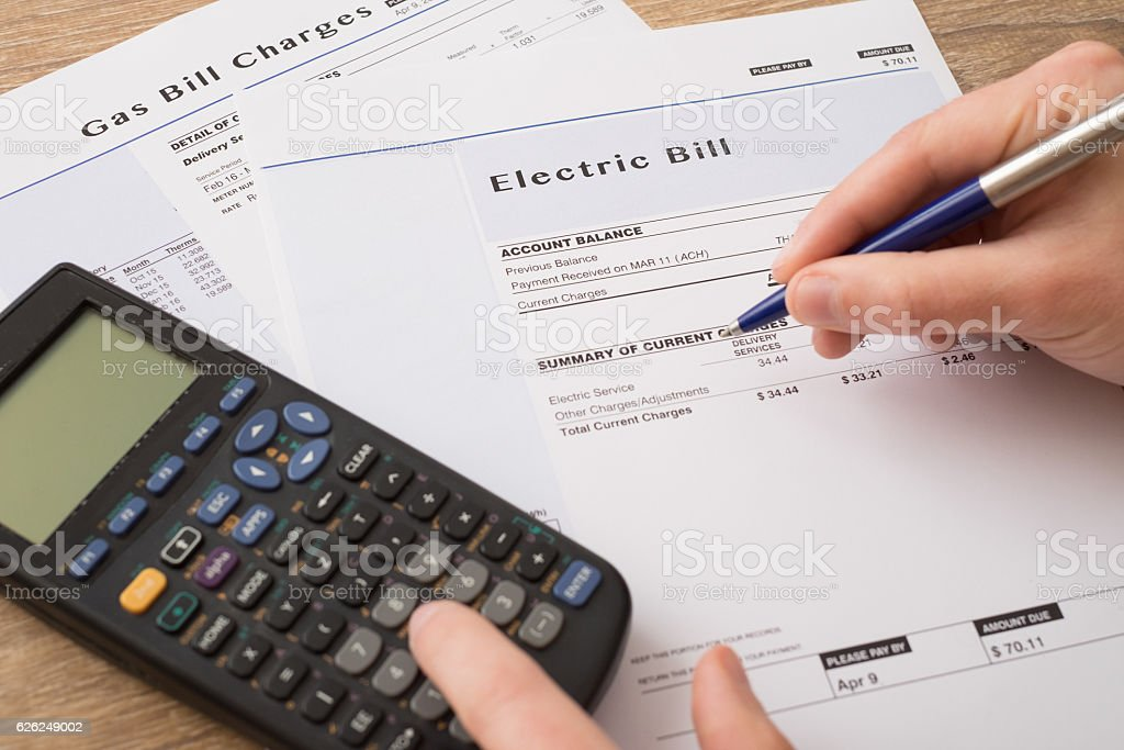 Electric bill charges paper form on the table stock photo