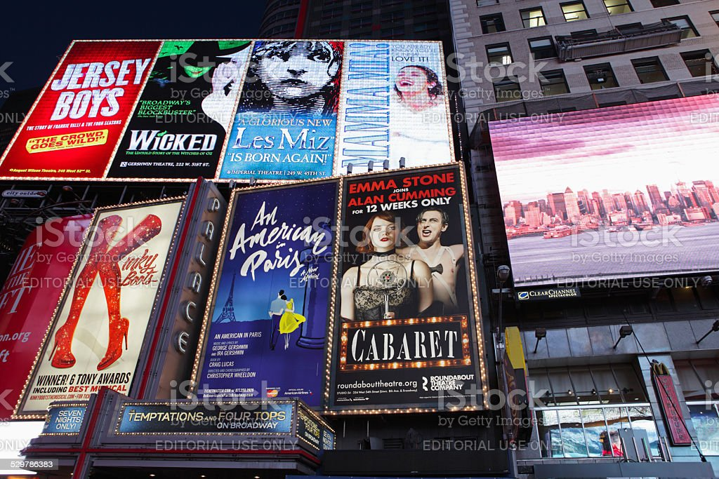 Electric billboards in Times Square New York advertising theatre stock photo