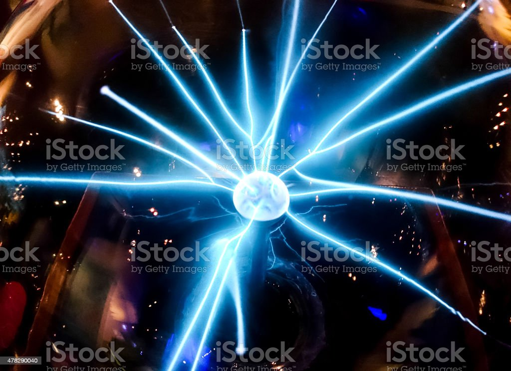 Electric blue beam spread from the middle ball Science dignitaries stock photo