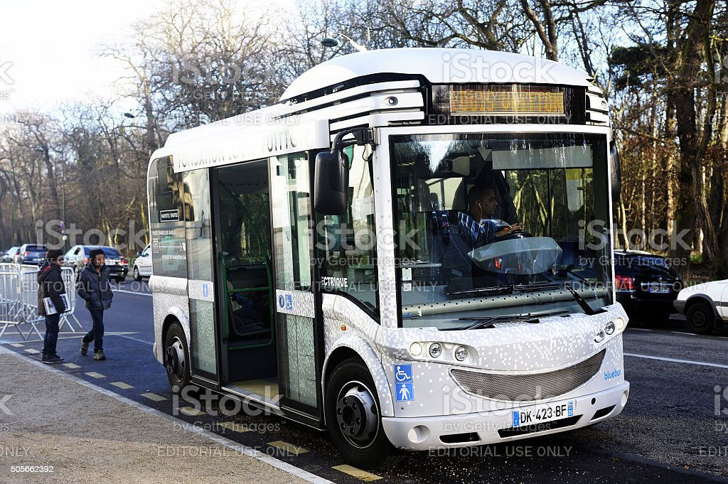 electric buses to transport visitors to the Foundation Louis Vuitton stock photo