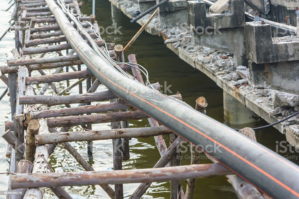 Electric cable during repair old bridge stock photo