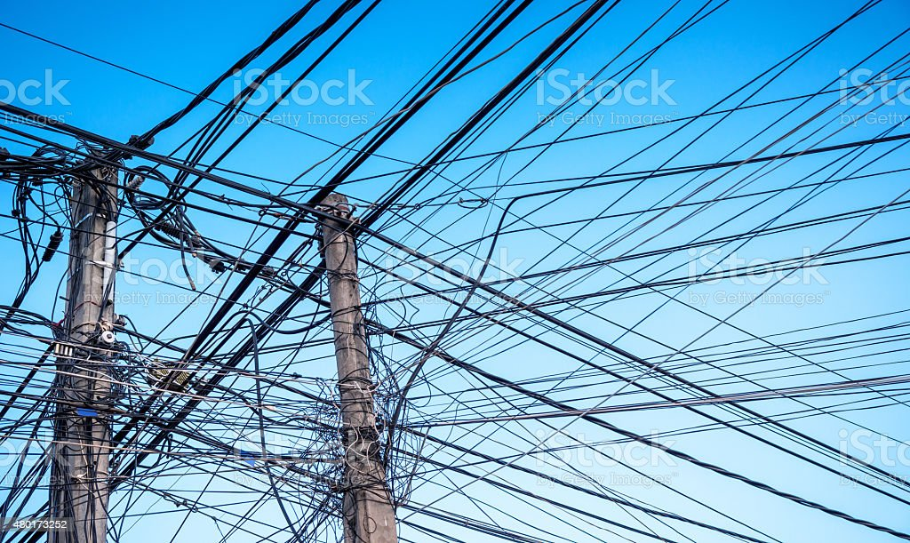 electric cables chaos in Asia stock photo