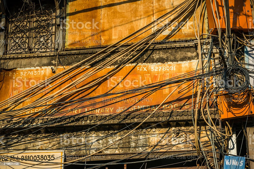 electric cables chaos in the streets of Old Delhi, India stock photo