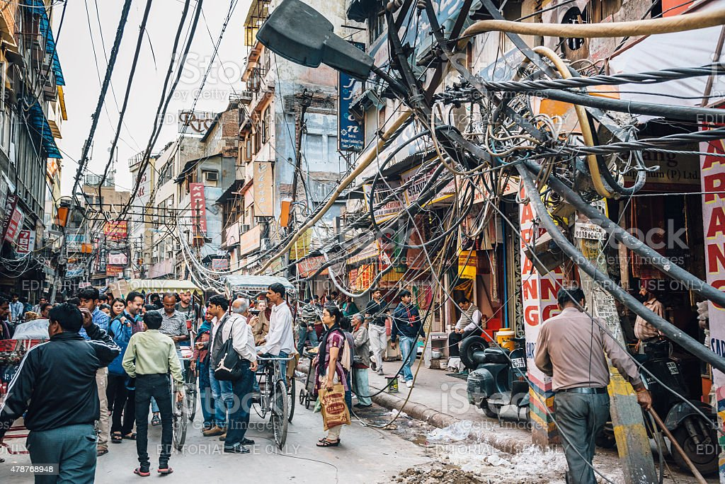 electric cables damage in the streets of Old Delhi stock photo