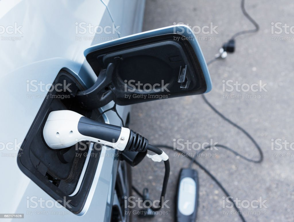 Electric car being charged. High angle view. stock photo