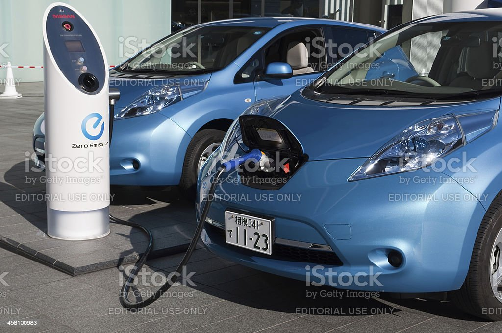 Electric car being charged royalty-free stock photo
