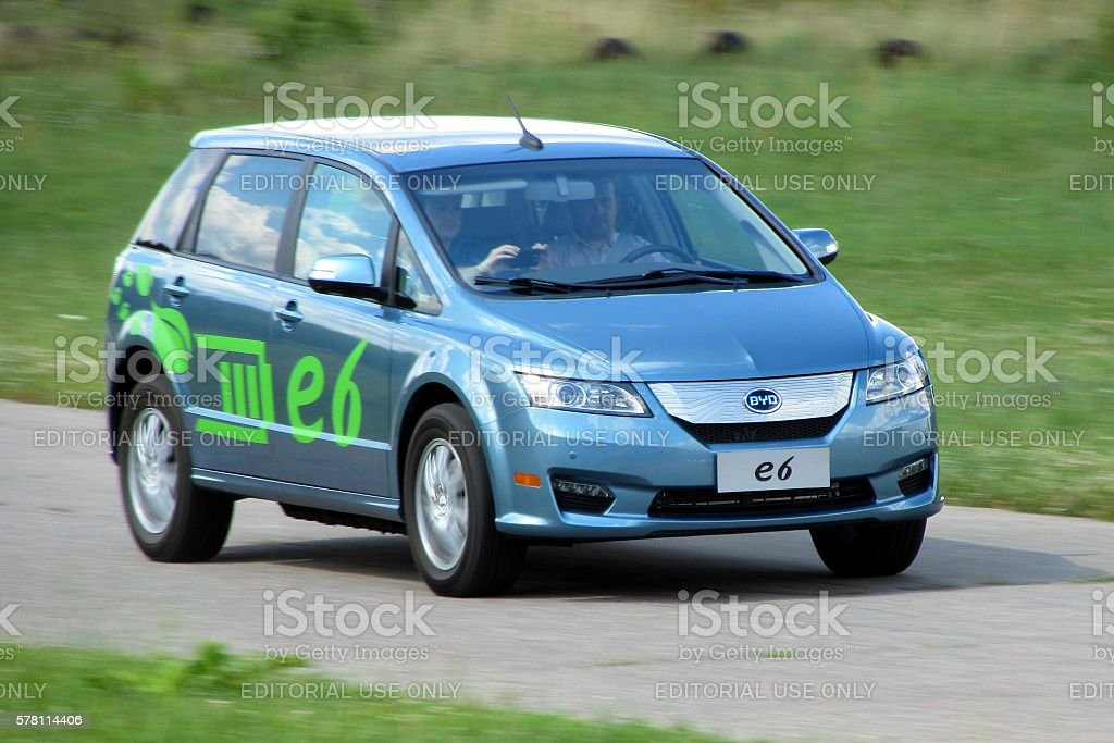 Electric car BYD e6 in motion stock photo