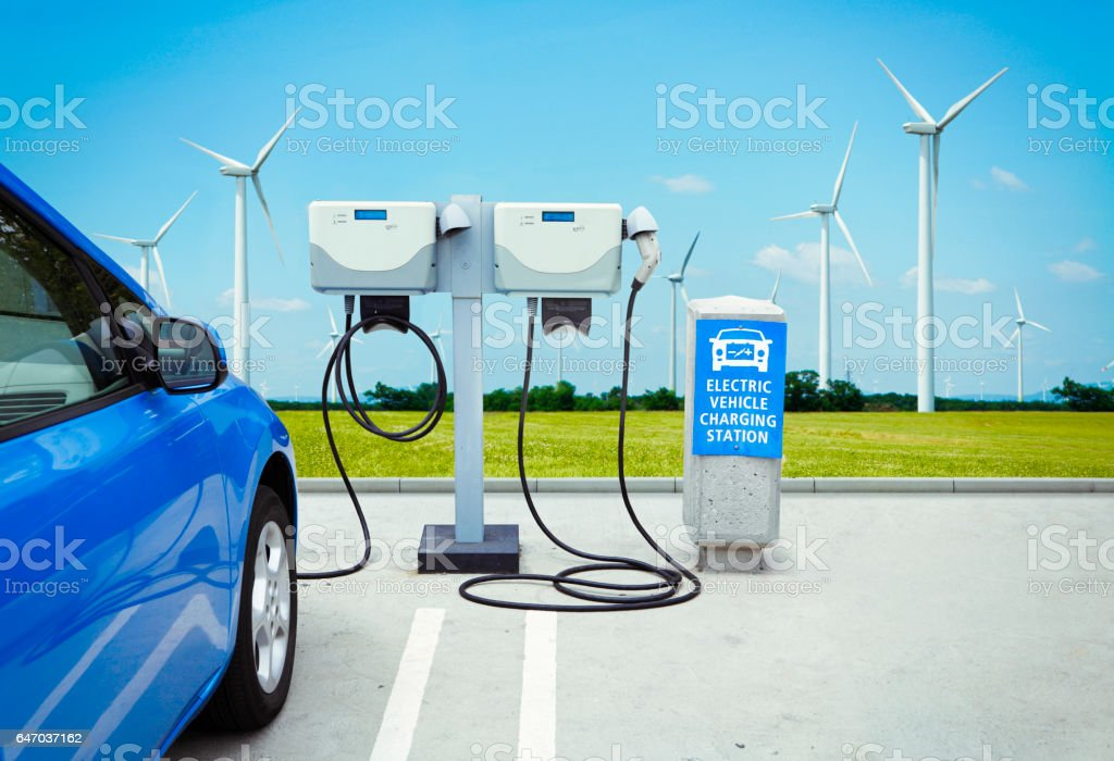 Electric car charging green energy stock photo