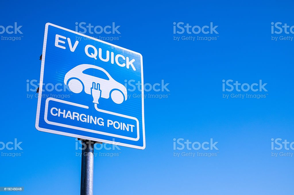 Electric car charging station sigh stock photo