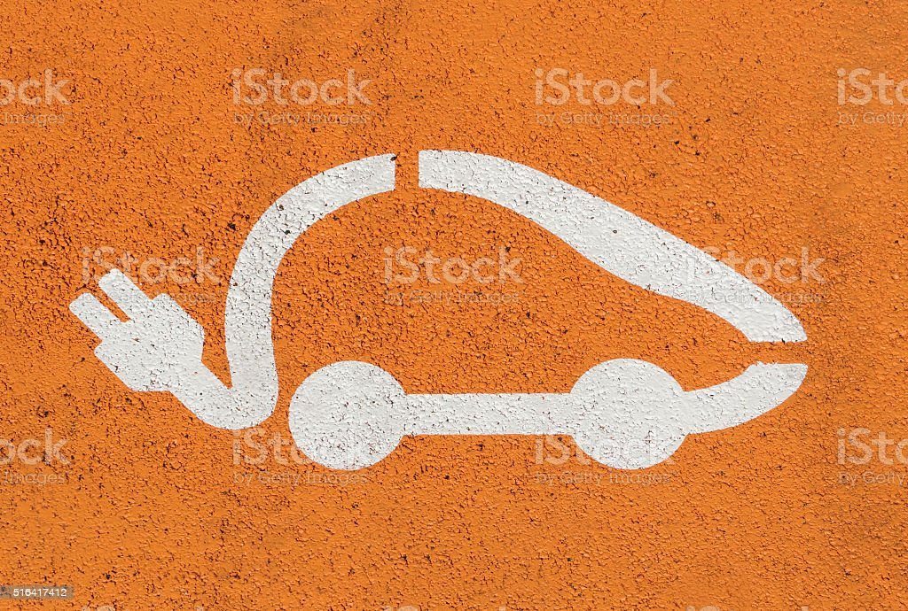 Electric car icon on street parking stock photo