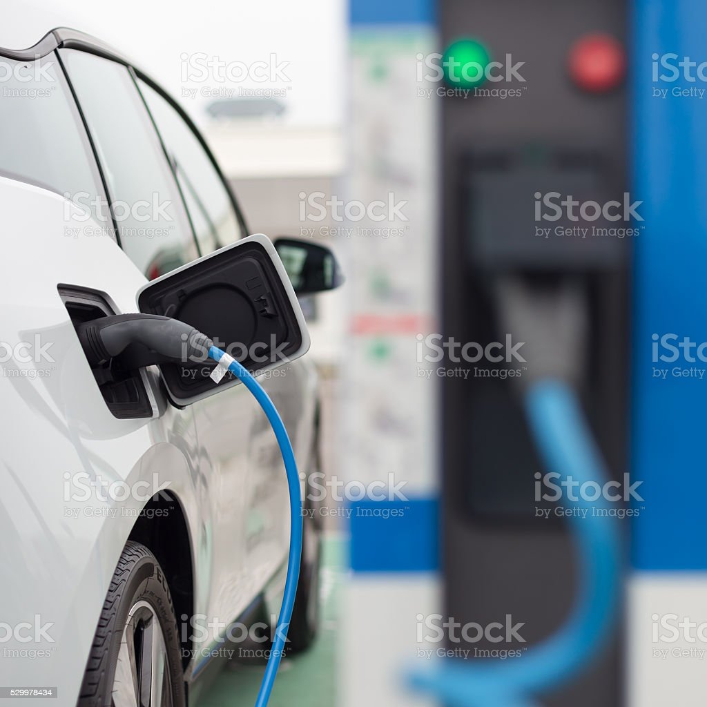 Electric Car in Charging Station. stock photo
