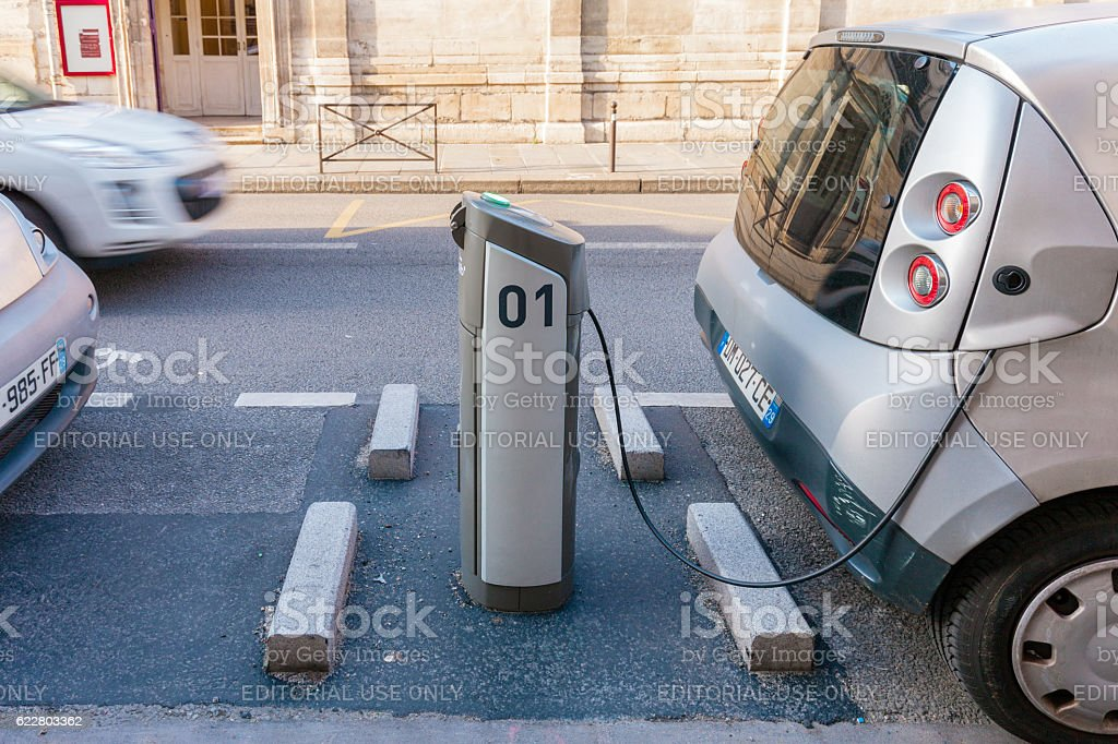 Electric Car in Charging Station stock photo