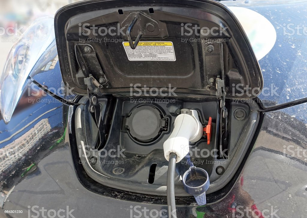Electric car is being charged stock photo