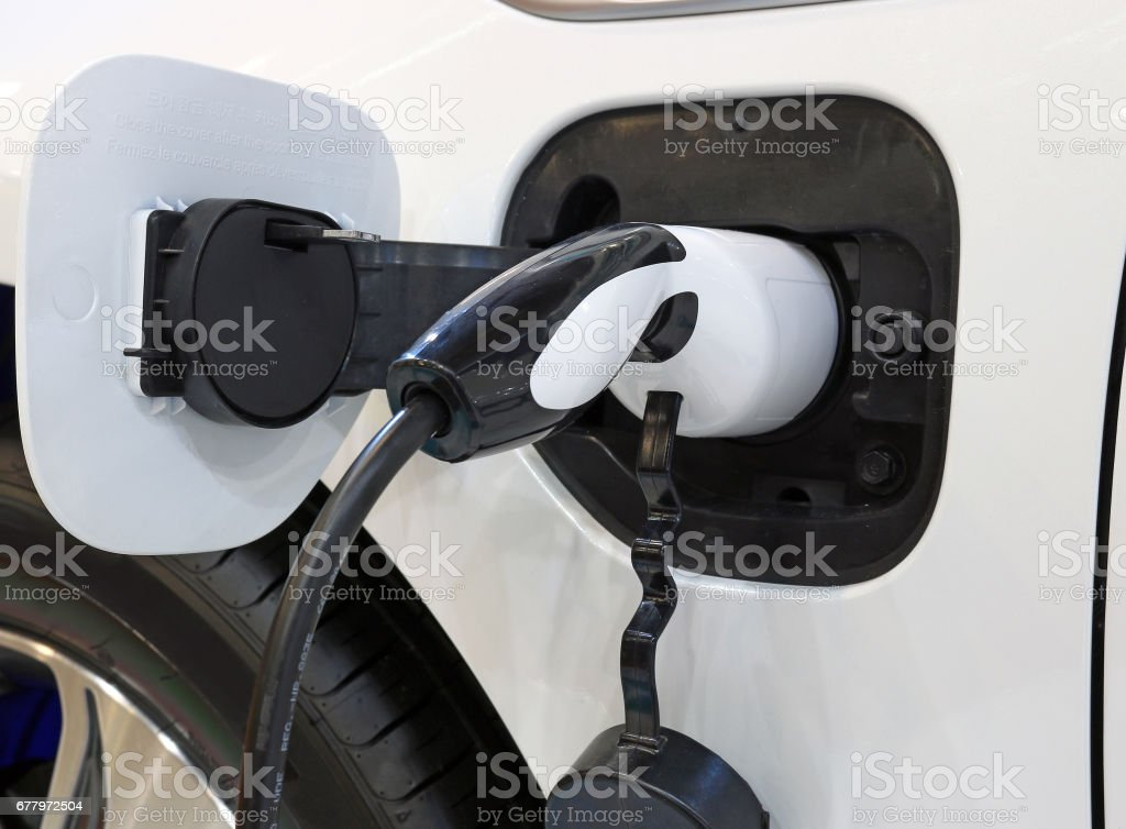 electric car is charging close up stock photo