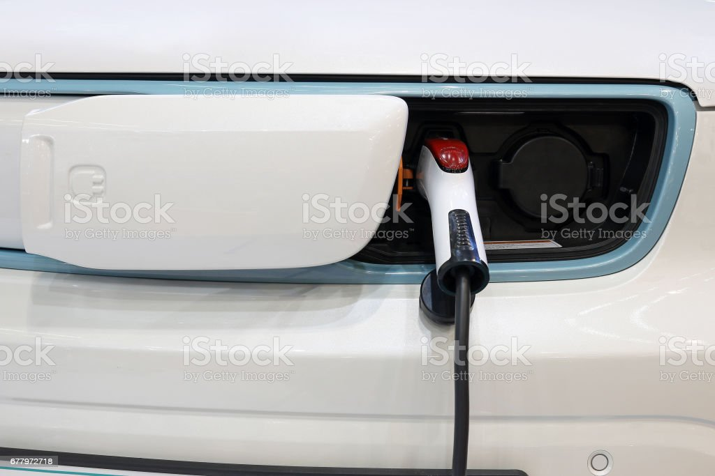electric car is charging front view stock photo