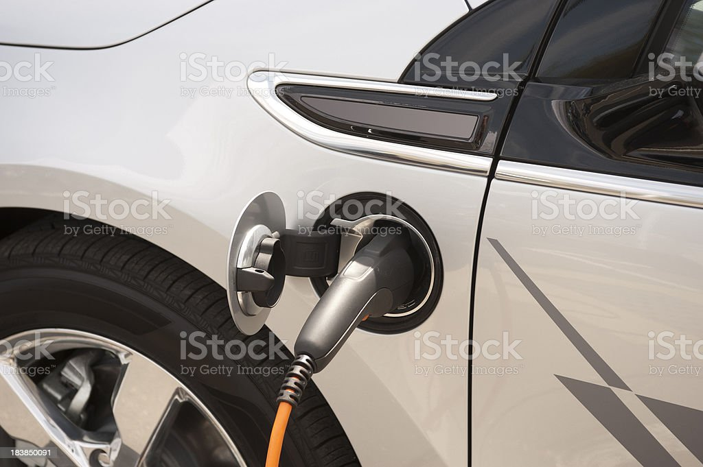 Electric Car plugged in royalty-free stock photo