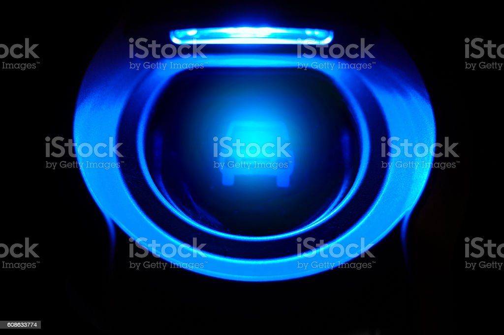 Electric car power charging plug at night stock photo