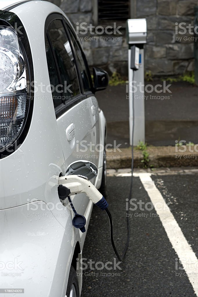 electric car recharging its battery royalty-free stock photo