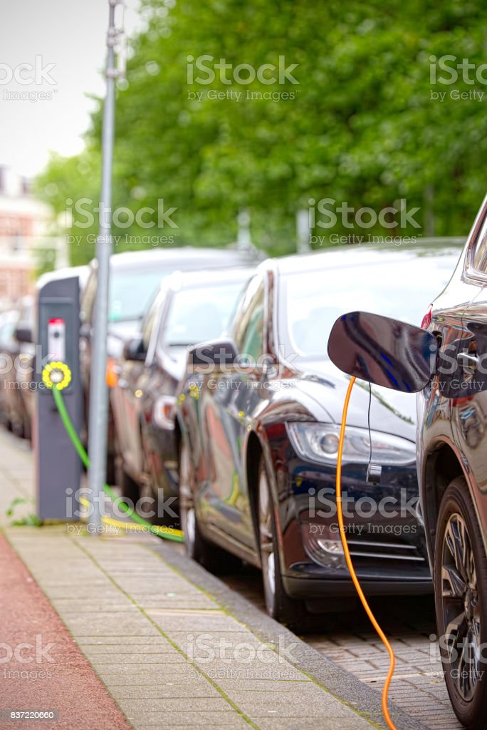 Electric cars charging on the road stock photo