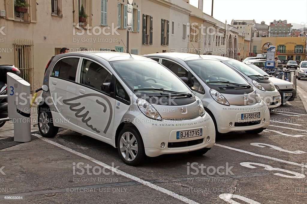Electric cars on the charging point stock photo
