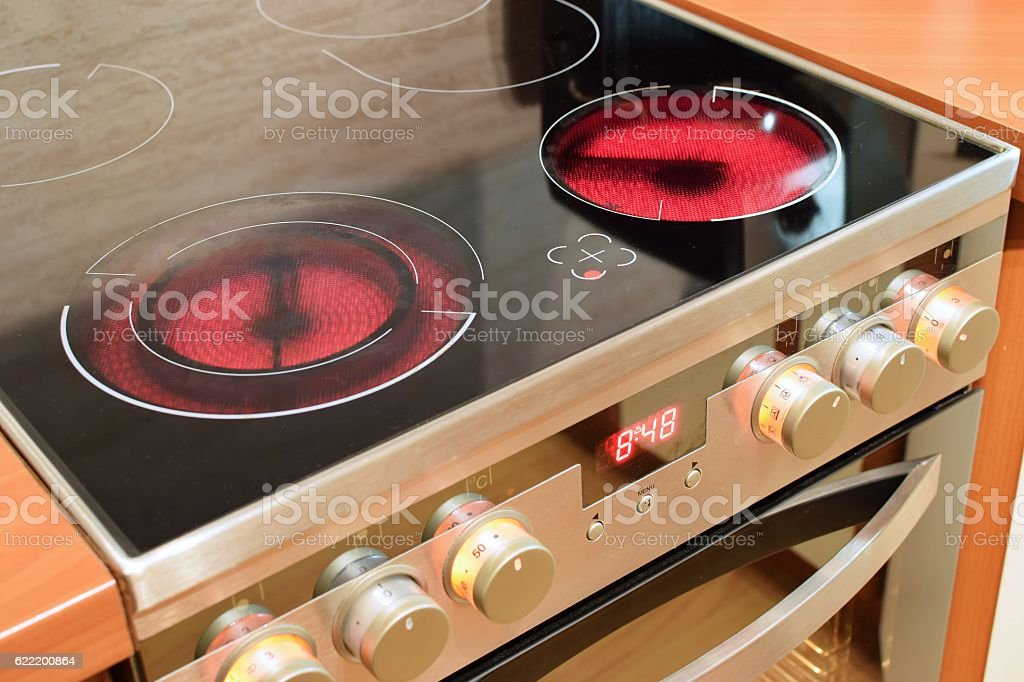 Electric ceramic stove inside the kitchen. Home interiors. stock photo