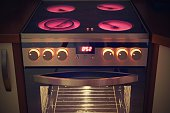 Electric ceramic stove inside the kitchen. Home interiors.